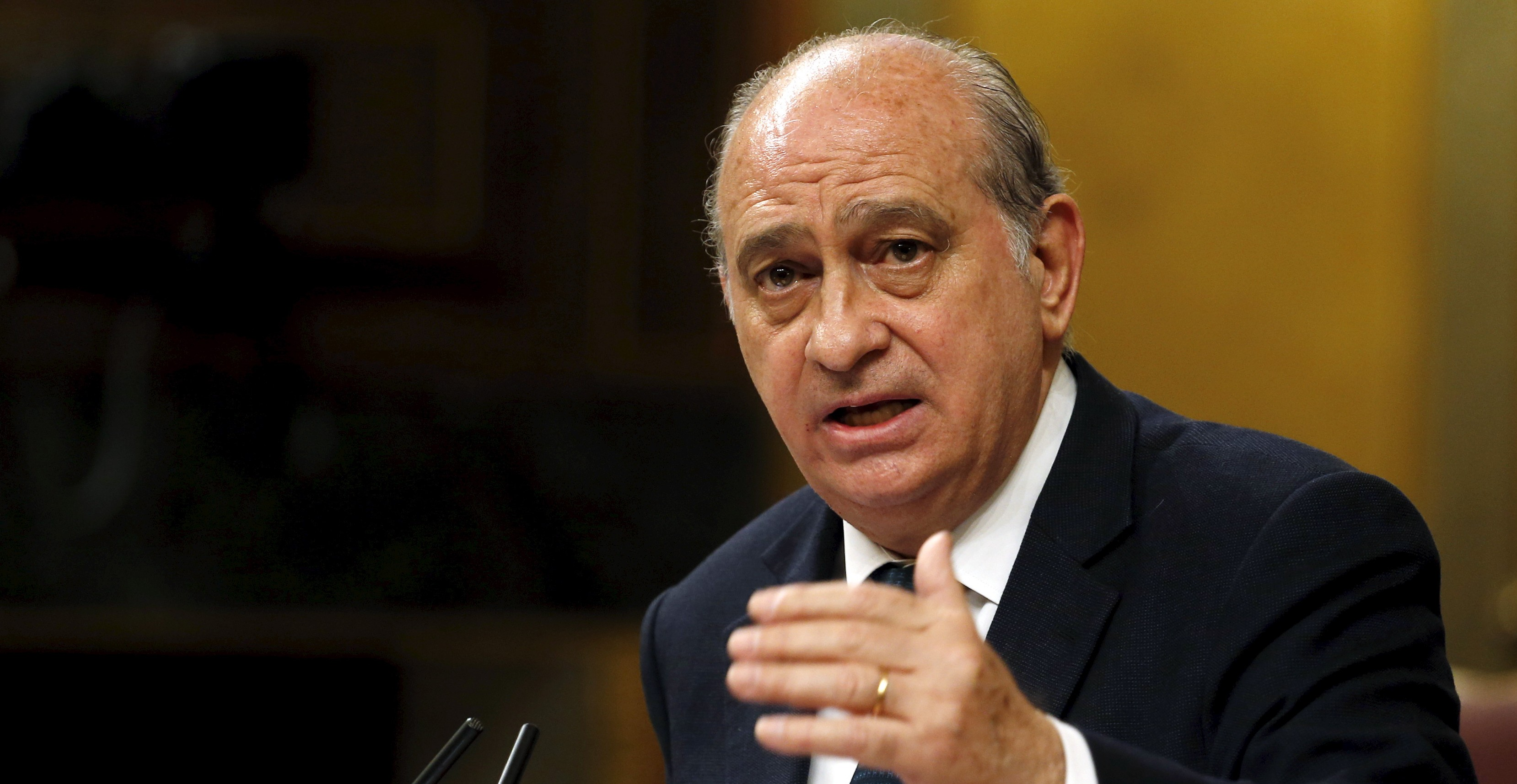 """Spain's Interior Minister Jorge Fernandez Diaz delivers a speech during a debate of the Spanish government's new security law, known as """"Ley Mordaza"""" (""""Gag Law""""), at Parliament in Madrid March 26, 2015. The bill has been approved by the conservative-led Spanish parliament today, despite heavy opposition from some politicians and activist groups, who say the law violates the right to protest, limits freedom of expression and gives more power to police. REUTERS/Juan Medina - RTR4V1BU"""