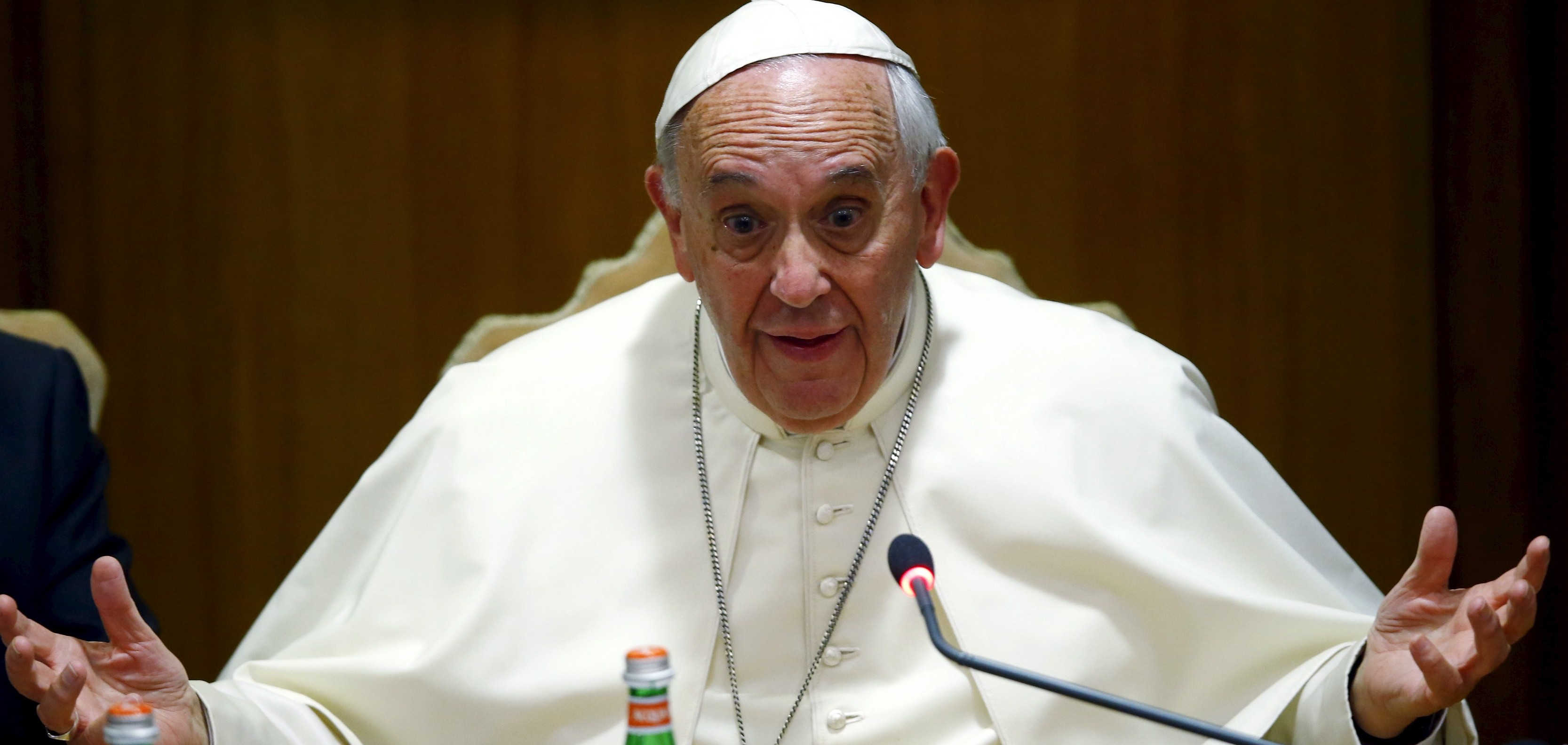 """Pope Francis gestures as he speaks during the """"Modern Slavery and Climate Change"""" conference at the Vatican July 21, 2015. Pope Francis on Tuesday urged the United Nations to take a """"very strong stand"""" on climate change at a landmark summit this year in Paris on global warming. The pope spoke at a Vatican-hosted conference of mayors and governors from major world cities who signed a declaration urging global leaders to take bold action at the U.N. summit, saying it may be the last chance to tackle human-induced global warming. REUTERS/Tony Gentile  - RTX1L91Q"""