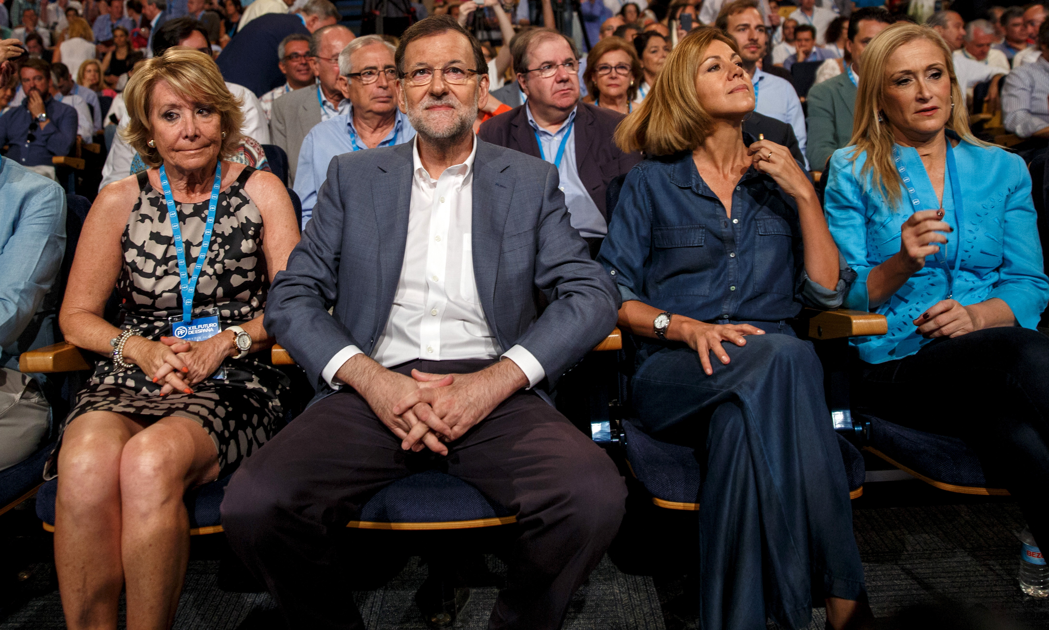 L-R: Madrid town hall councillor Esperanza Aguirre, Prime Minister Mariano Rajoy, People's Party (PP) party secretary, Maria Dolores de Cospedal and Madrid regional president Cristina Cifuentes attend a party rally in Madrid, Spain, July 11, 2015. Spain said on Friday it would cut central government spending further in 2016, offsetting broad-based tax cuts unveiled last week as it looks to keep a healthy economic recovery on track ahead of national elections. REUTERS/Andrea Comas - RTX1JZCM