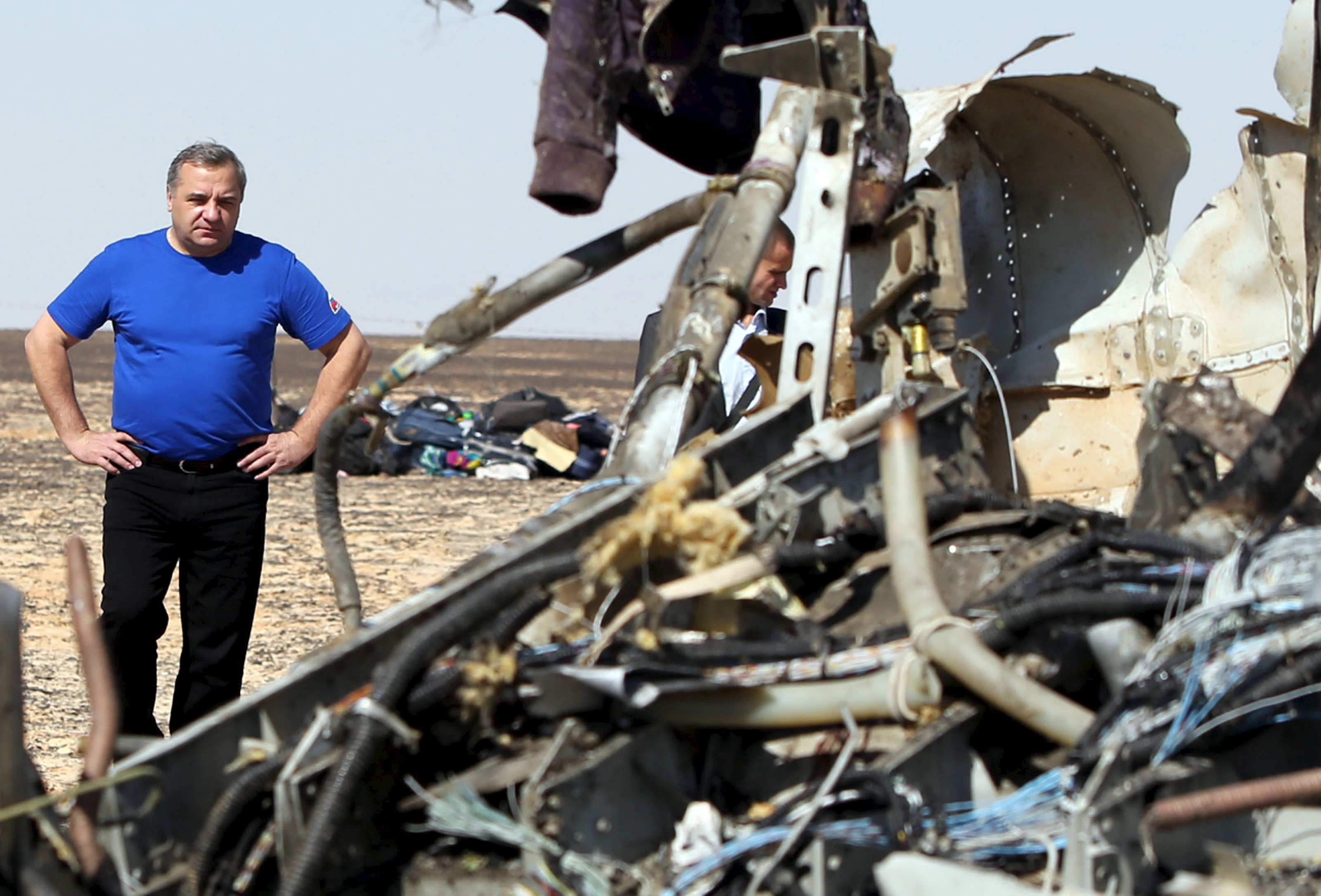 Russian Emergencies Minister Vladimir Puchkov looks at debris from a Russian airliner at its crash site at the Hassana area in Arish city, north Egypt, November 1, 2015. Russia has grounded Airbus A321 jets flown by the Kogalymavia airline, Interfax news agency reported on Sunday, after one of its fleet crashed in Egypt's Sinai Peninsula, killing all 224 people on board. REUTERS/Mohamed Abd El Ghany - RTX1U8KZ