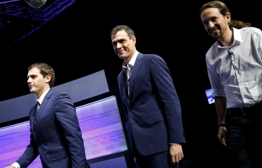Three of the main candidates for Spain's national election (L-R) Ciudadanos party leader Albert Rivera, Socialist party (PSOE) leader Pedro Sanchez and Podemos (We Can) party leader Pablo Iglesias, walk together before a live debate hosted by Spanish newspaper El Pais in Madrid, November 30, 2015. REUTERS/Juan Medina - RTX1WKKF
