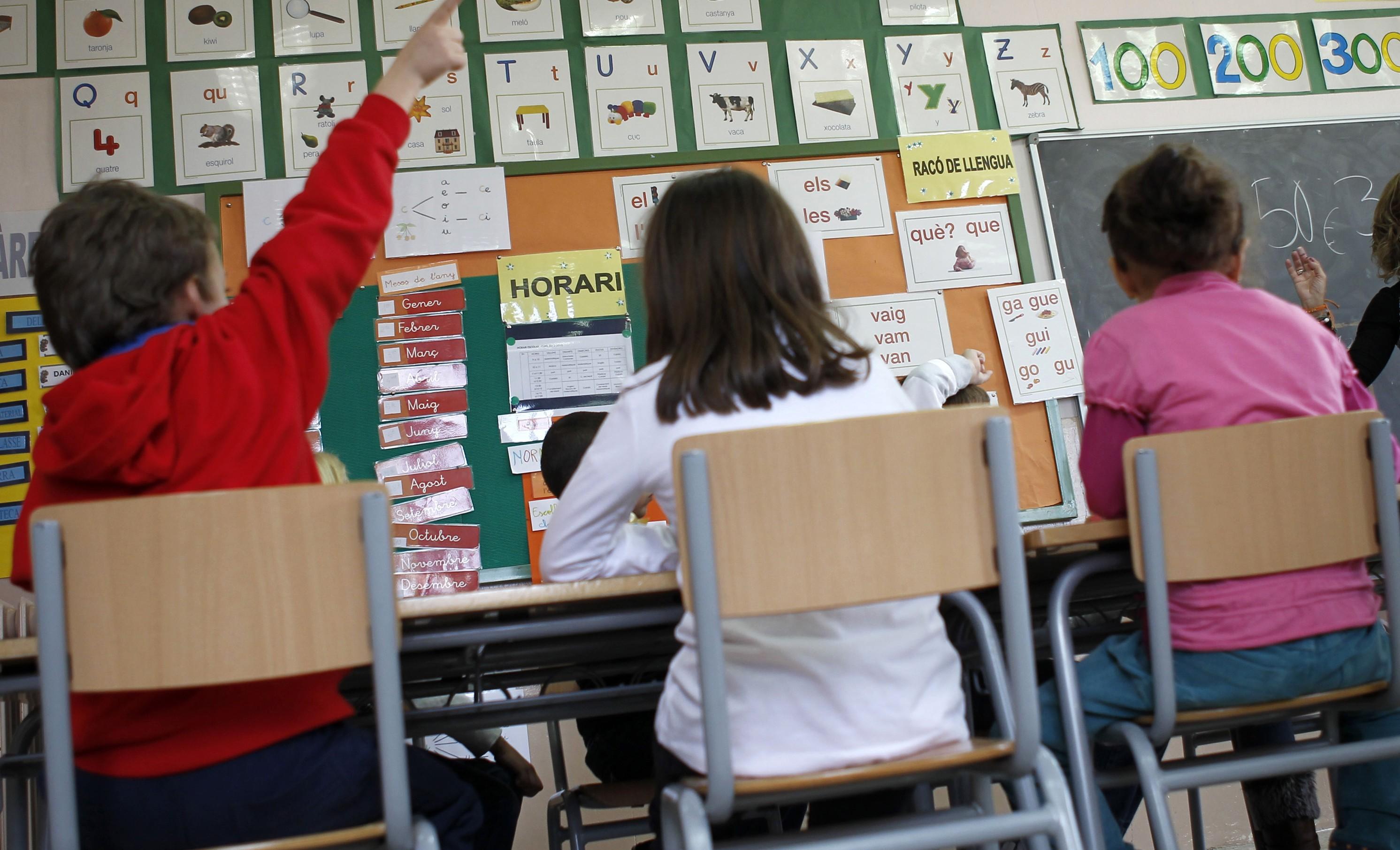 Alumnos en un colegio de Barcelona. | Reuters