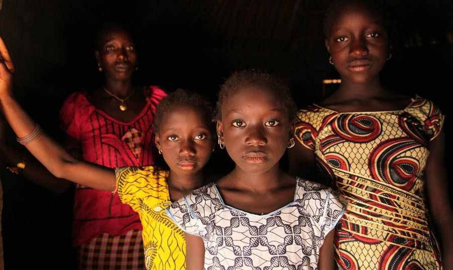 A woman and her daughters stand in their home, in the village of Cambadju in Bafatá Region. Their village is the first in the country to renounce female genital mutilation/cutting (FGM/C). The harmful traditional practice, which can result in irreversible, life-long health and other complications, as well as psychological harm, was renounced in the village that same day, during a ceremony organized with support from the international NGO Tostan, a UNICEF partner. The event was attended by girls and young women, former traditional cutters, delegates from youth and women's groups, government officials and others. Between 2006 and 2010, the percentage of girls and women aged 15 to 49 years of age subjected to FGM/C in Guinea-Bissau increased from 45 per cent to 50 per cent – and reached 94 per cent in eastern parts of the country. Together with Tostan and other partners, UNICEF supports interventions that help communities decide for themselves to renounce the practice.  In November/December 2012 in Guinea-Bissau, a vaccination campaign against measles was held as part of an effort by the Government and the Measles & Rubella Initiative, a multi-partner effort led by the American Red Cross, the United Nations Foundation, the United States Centers for Disease Control and Prevention (CDC), the World Health Organization (WHO) and UNICEF. In Guinea-Bissau, political instability and deep poverty continue to contribute to limiting economic and social development. The country has the seventh-highest under-five mortality rate in the world, despite a decline (from 210 to 161 deaths per 1,000 live births) from 1990 to 2011, and maternal mortality is also high. One-third of the population and half of all rural inhabitants lack access to safe water. More than 80 per cent of the population have no access to sanitation. Cholera continues to be endemic, and HIV prevalence is 5.3 per cent among adults, with women disproportionately affected. Wide economic, gender and other disparit