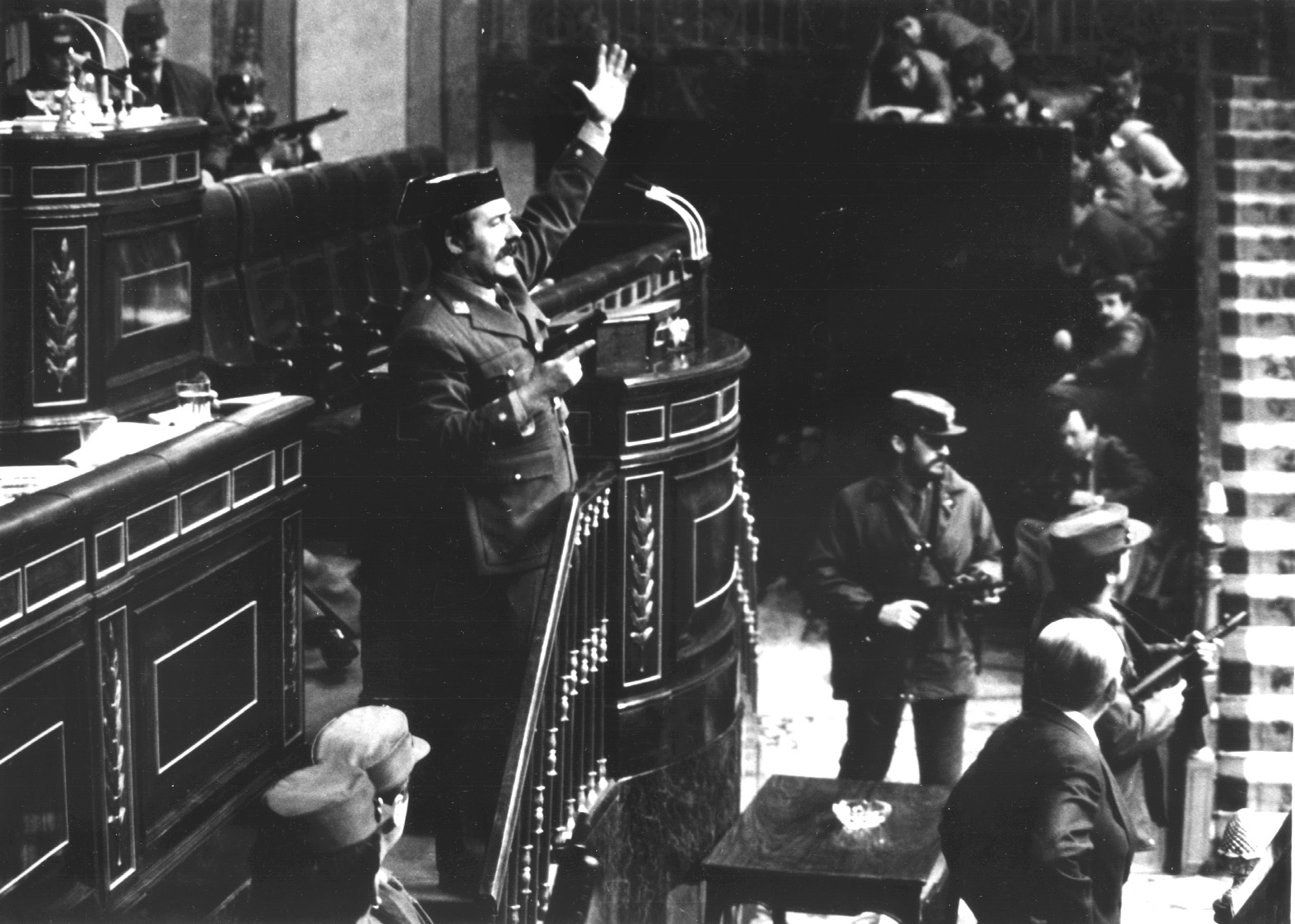 Civil Guard Lieutenant General Antonio Tejero waves a pistol inside parliament as Civil Guards stormed the building and held the government hostage in this February 23, 1981 file picture. Twenty years ago this Friday Spain's new democracy hung by a thread as 300 Civil Guards attempted to replace it with a military-led government in a failed coup attempt.  PH/WS - RTRENT5