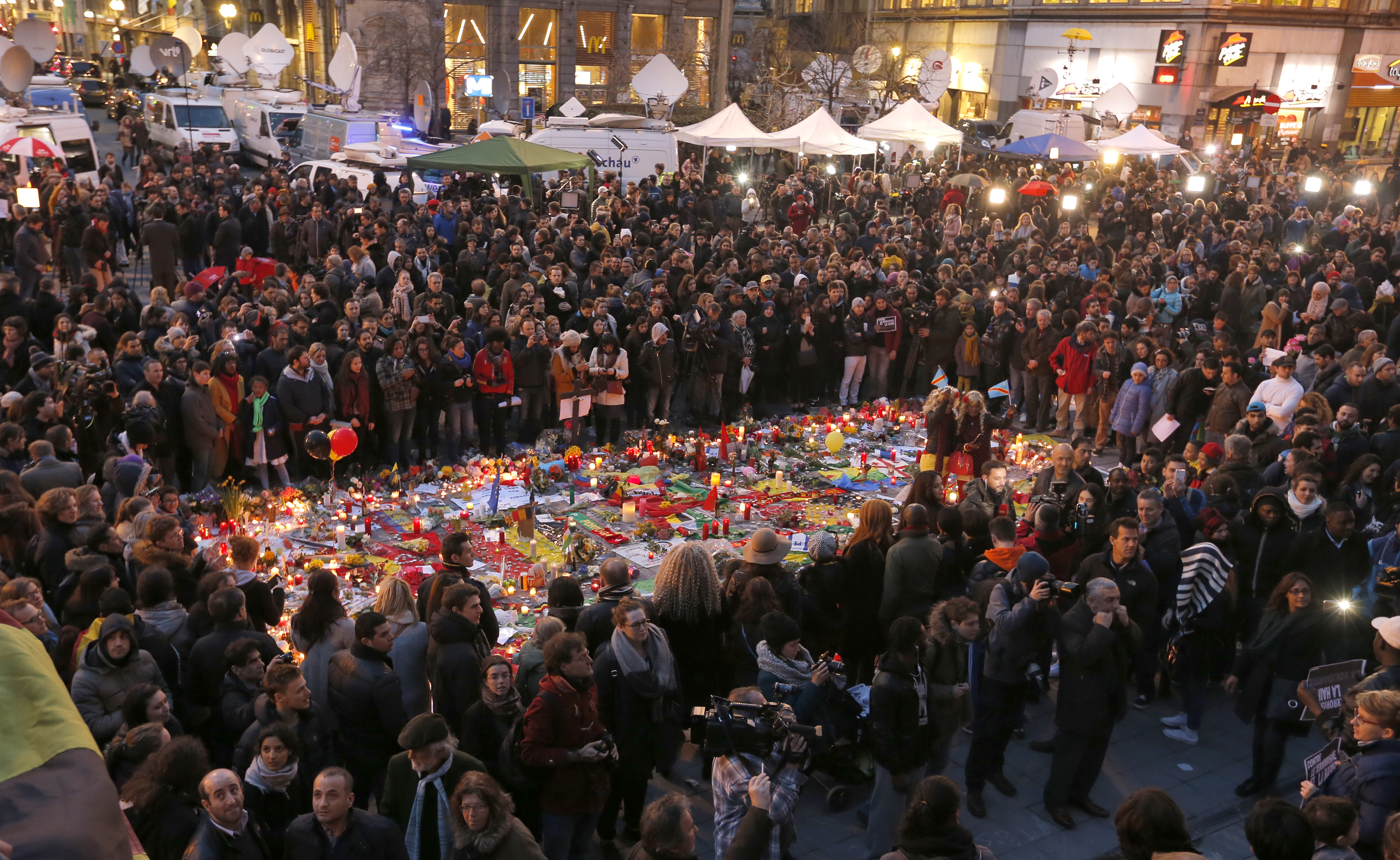 People attend a street memorial service near the old stock exchange in Brussels following Tuesday's bomb attacks in Brussels, Belgium, March 23, 2016.     REUTERS/Vincent Kessler - RTSBY63