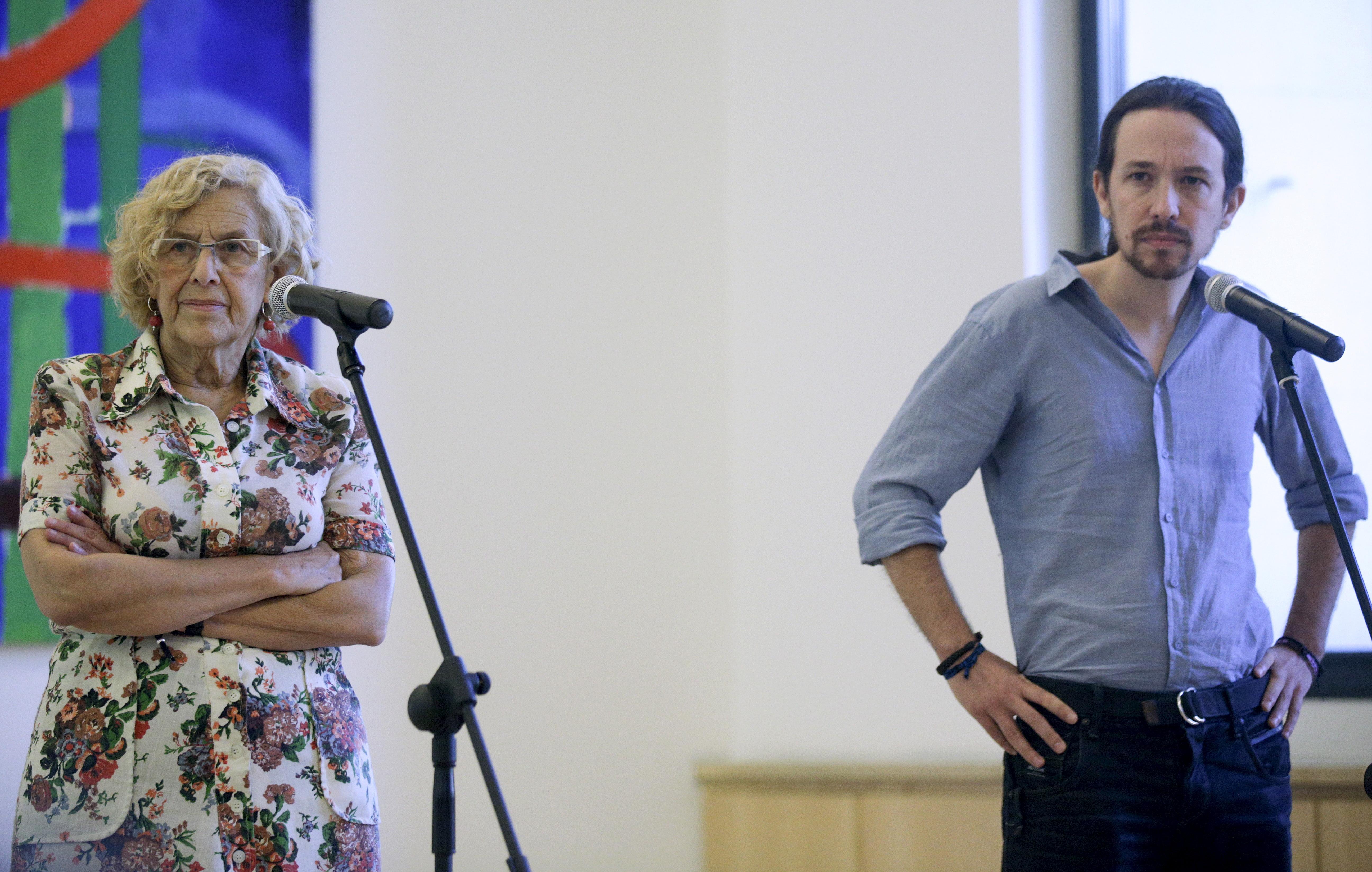 Manuela Carmena y Pablo Iglesias. FOTO: Reuters