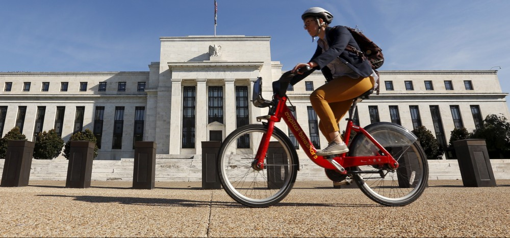 A cyclist passes the Federal Reserve headquarters in Washington September 16, 2015. The Federal Reserve, facing this week its biggest policy decision yet under Chair Janet Yellen, puts its credibility on the line regardless of whether it waits or raises interest rates for the first time in nearly a decade.       REUTERS/Kevin Lamarque  - RTS1E8N