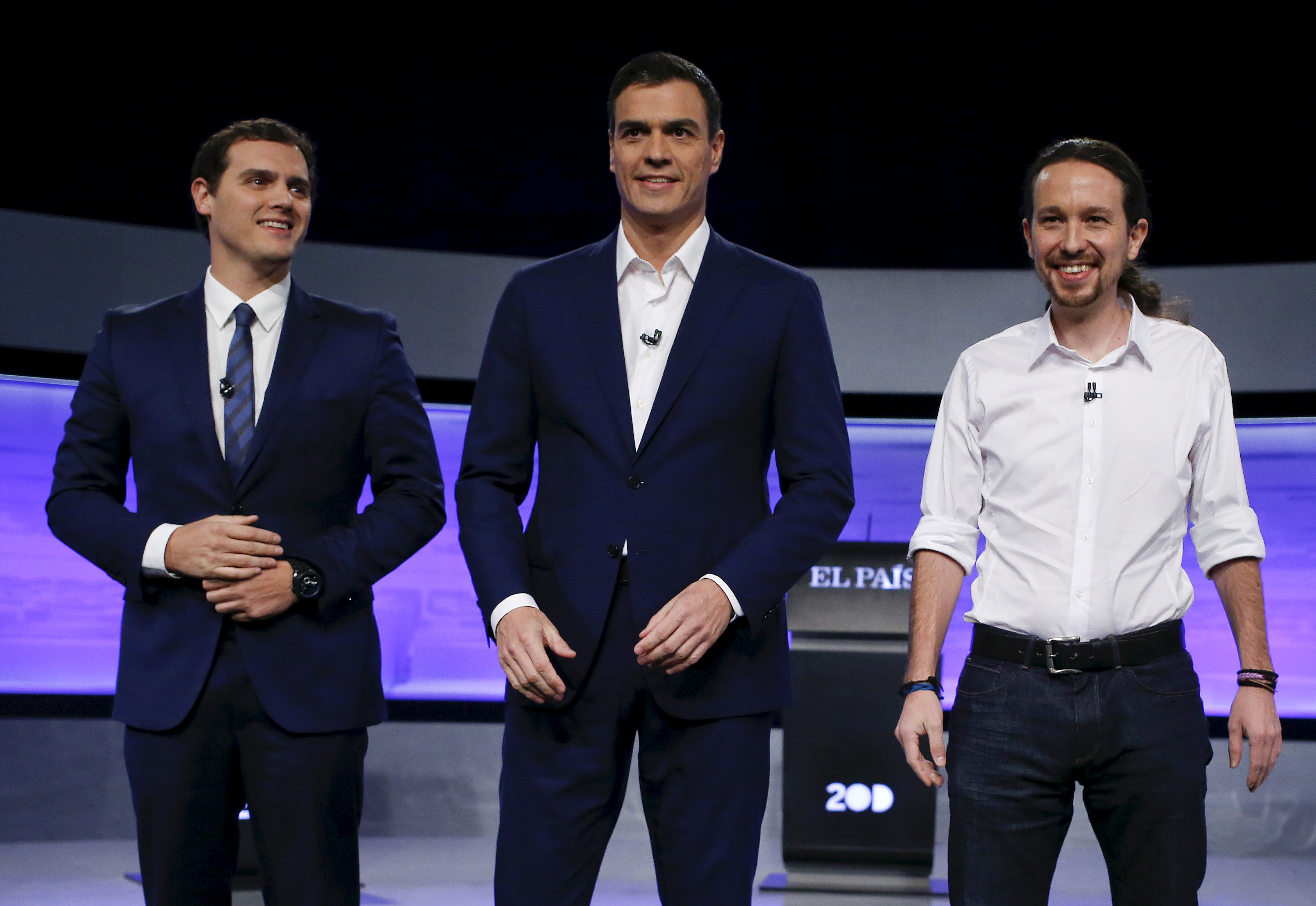 Three of the main candidates for Spain's national election (L-R) Ciudadanos party leader Albert Rivera, Socialist party (PSOE) leader Pedro Sanchez, and Podemos (We Can) party leader Pablo Iglesias,  pose before a live debate hosted by Spanish newspaper El Pais in Madrid, November 30, 2015. REUTERS/Juan Medina - RTX1WKJS