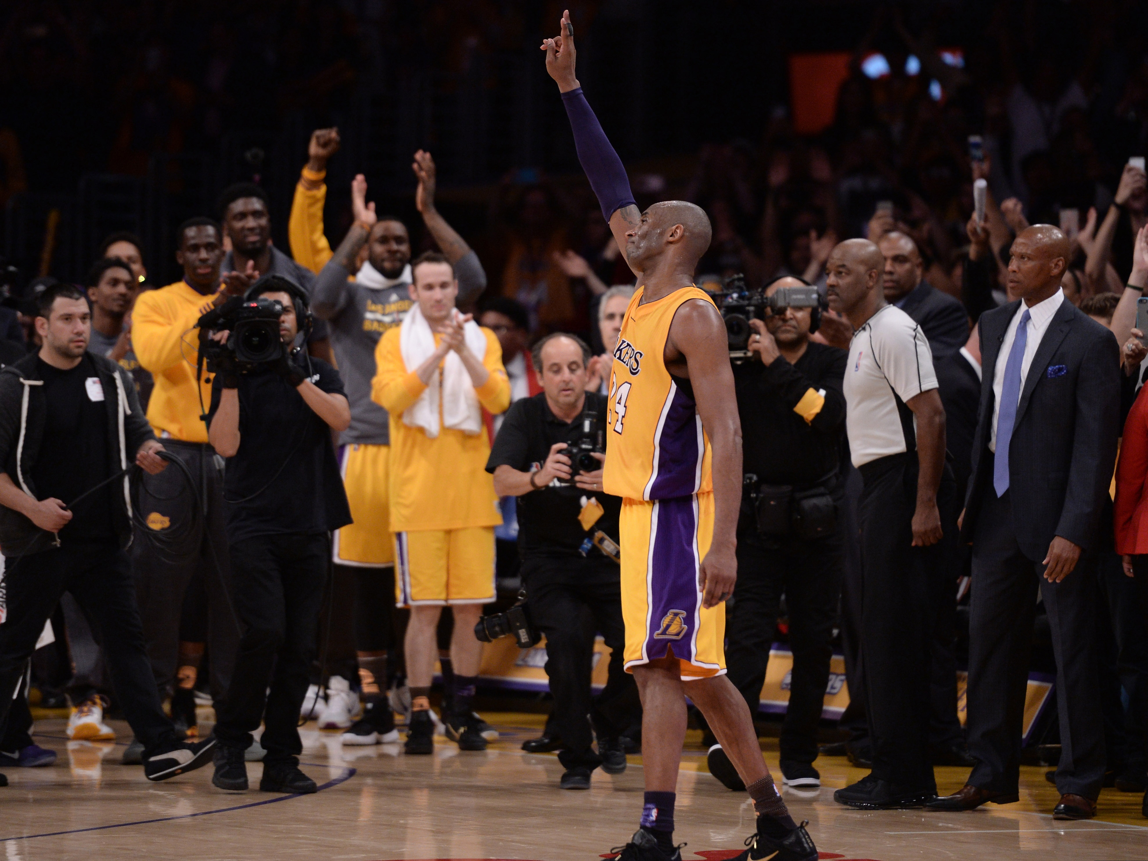 Apr 13, 2016; Los Angeles, CA, USA; Los Angeles Lakers forward Kobe Bryant (24) waves to the Staples Center crowd as he leaves the game against the Utah Jazz in the closing seconds. Bryant scored 60 points in the final game of his career. Mandatory Credit: Robert Hanashiro-USA TODAY Sports - RTX29VHM