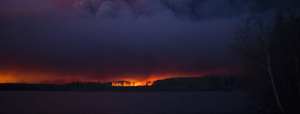 A massive wildfire, which caused a mandatory evacuation, rages south of Fort McMurray near Anzac, Alberta, Canada May 4, 2016. .  Chris Schwarz/Government of Alberta/Handout via REUTERS  ATTENTION EDITORS - THIS IMAGE WAS PROVIDED BY A THIRD PARTY. EDITORIAL USE ONLY. FOR EDITORIAL USE ONLY. NOT FOR SALE FOR MARKETING OR ADVERTISING CAMPAIGNS. THIS IMAGE HAS BEEN SUPPLIED BY A THIRD PARTY. IT IS DISTRIBUTED, EXACTLY AS RECEIVED BY REUTERS, AS A SERVICE TO CLIENTS - RTX2D1PL