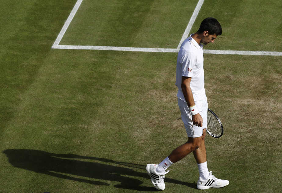 Britain Tennis - Wimbledon - All England Lawn Tennis & Croquet Club, Wimbledon, England - 2/7/16 Serbia's Novak Djokovic reacts after losing his match against USA's Sam Querrey REUTERS/Stefan Wermuth - RTX2JDXS