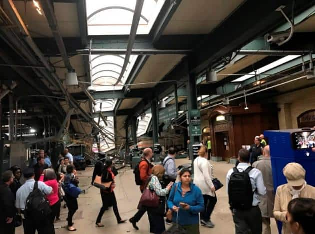 Onlookers view a New Jersey Transit train that derailed and crashed through the station in Hoboken, New Jersey, U.S. in this picture courtesy of David Richman taken September 29, 2016. Courtesy of David Richman via REUTERS