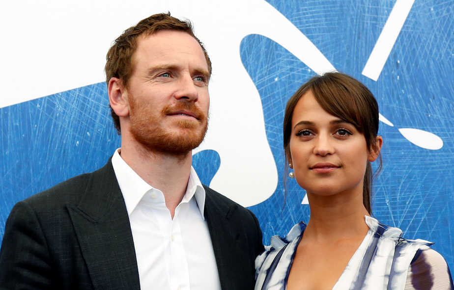 "Actors Michael Fassbender (L) and Alicia Vikander pose as they attend the photocall for the movie ""The Light Between Oceans"" at the 73rd Venice Film Festival in Venice, Italy September 1, 2016. REUTERS/Alessandro Bianchi - RTX2NRGT"