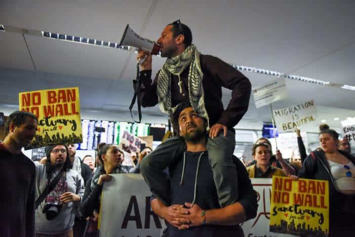 Demonstrators shout slogans during anti-Donald Trump immigration ban protests inside Terminal 4 at San Francisco International Airport in San Francisco, California, U.S., January 28, 2017. REUTERS/Kate Munsch