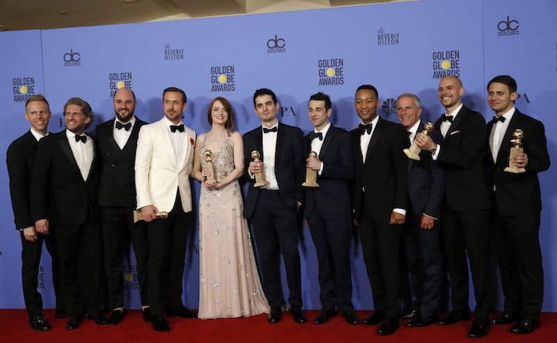 """The cast and crew of """"La La Land"""" pose after winning the award for Best Motion Picture - Musical or Comedy among other awards backstage during the 74th Annual Golden Globe Awards in Beverly Hills, California, U.S., January 8, 2017.  REUTERS/Mario Anzuoni"""