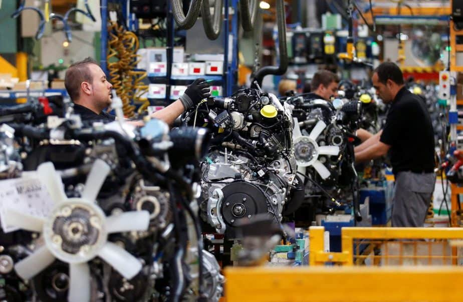 Nissan Motor staff work on an engine in the assembly line at the Zona Franca Nissan factory near Barcelona May 5, 2014. REUTERS/Albert Gea/File Photo GLOBAL BUSINESS WEEK AHEAD PACKAGE Ð SEARCH ÒBUSINESS WEEK AHEAD JULY 4Ó FOR ALL IMAGES - RTX2JK6R