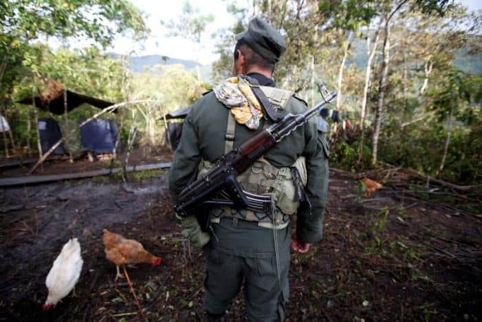 A member of the 51st Front of the Revolutionary Armed Forces of Colombia (FARC) walks at a camp in Cordillera Oriental, Colombia, August 16, 2016.  REUTERS/John Vizcaino