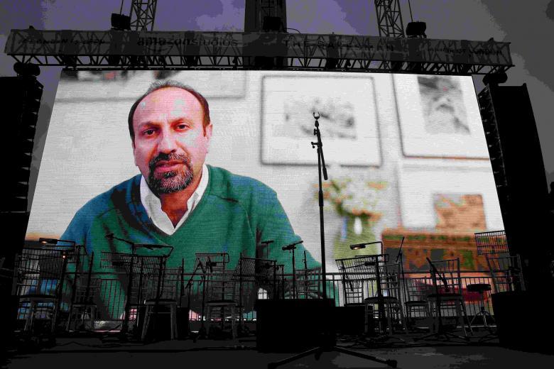 Director Asghar Farhadi speak via a video link at the screening of the film The Salesman in Trafalgar Square in London, Britain February 26, 2017. REUTERS/Neil Hall