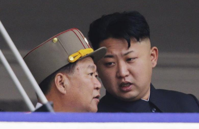 North Korean leader Kim Jong-un speaks to Choe Ryong-hae (L), director of the General Political Bureau of the Korean People's Army (KPA), during a parade to commemorate the 60th anniversary of the signing of a truce in the 1950-1953 Korean War, at Kim Il-sung Square in Pyongyang July 27, 2013. REUTERS/Jason Lee