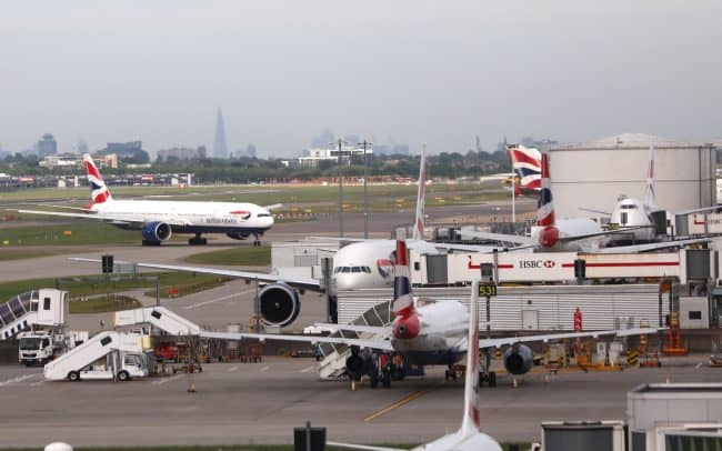 British Airways planes are seen at Heathrow Terminal 5 in London, Britain May 27, 2017. REUTERS/Neil Hall - RTX37W6F