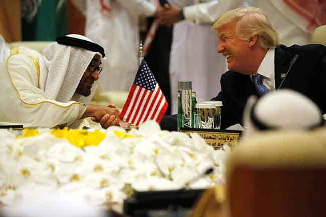 U.S. President Donald Trump shakes hands with Abu Dhabi Crown Prince and Deputy Supreme Commander of the United Arab Emirates (UAE) Armed Forces Mohammed bin Zayed al-Nahayan as he sits down to a meeting with of Gulf Cooperation Council leaders during their summit in Riyadh, Saudi Arabia May 21, 2017. REUTERS/Jonathan Ernst - RTX36SZO