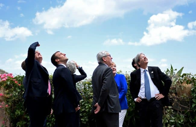 (L-R) U.S. President Donald Trump, French President Emmanuel Macron, Britain's Prime Minister Theresa May, the President of the European Commission Jean-Claude Juncker, German Chancellor Angela Merkel and Italian Prime Minister Paolo Gentiloni watch an Italian flying squadron as part of activities at the G7 Summit in Taormina, Sicily, Italy, May 26, 2017.   REUTERS/Stephane De Sakutin/Pool  TPX IMAGES OF THE DAY - RTX37SB1