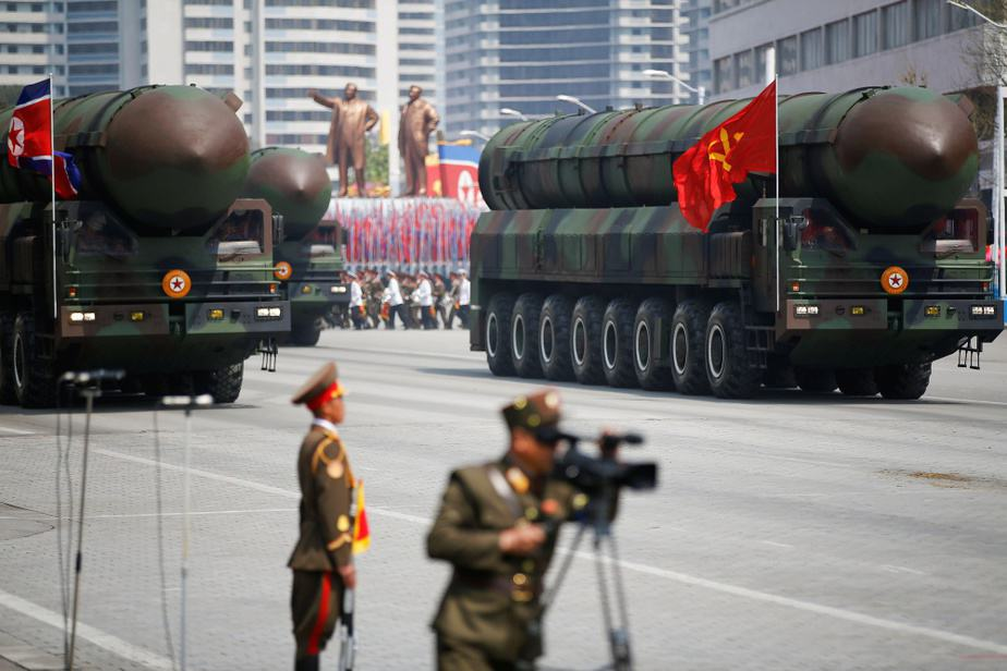 """Intercontinental ballistic missiles (ICBM) are driven past the stand with North Korean leader Kim Jong Un and other high ranking officials during a military parade marking the 105th birth anniversary of country's founding father Kim Il Sung, in Pyongyang April 15, 2017. The missiles themselves were shown for the first time inside a new kind of canister-based launcher on Saturday. The trucks upon which they are mounted are originally designed to move lumber. REUTERS/Damir Sagolj SEARCH """"PARADE WID"""" FOR THIS STORY. SEARCH """"WIDER IMAGE"""" FOR ALL STORIES. - RTS12G48"""