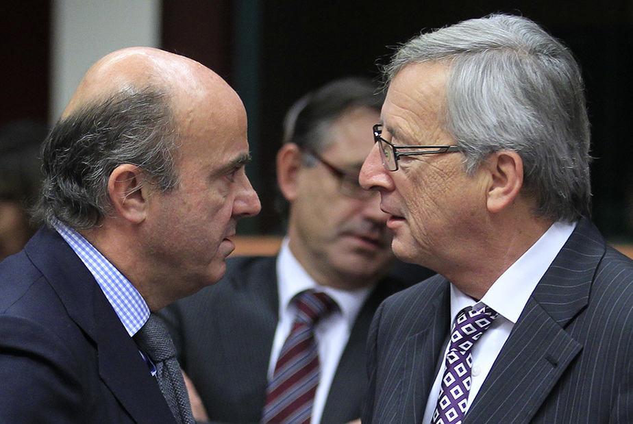 Luis de Guindos y Jean Claude Juncker. FOTO: Reuters