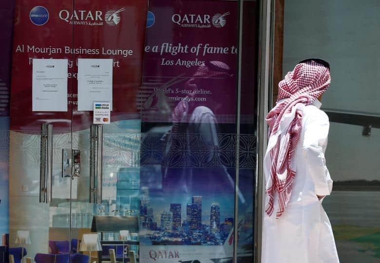 A man walks past Qatar Airways office in Riyadh, Saudi Arabia, June 5, 2017. REUTERS/Faisal Al Nasser