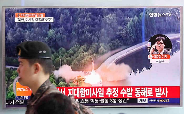 A South Korean soldier walks past a TV broadcast of a news report on North Korea firing what appeared to be several land-to-ship missiles off its east coast, at a railway station in Seoul, South Korea, June 8, 2017.  REUTERS/Kim Hong-Ji - RTX39JU8