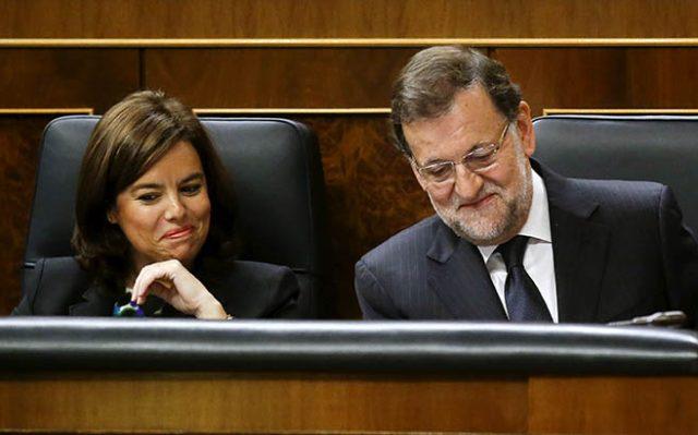 Soraya Sáenz de Santamaría y Mariano Rajoy. FOTO: Reuters