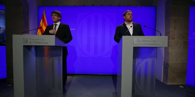 Catalan Regional President Carles Puigdemont (L) and Vice President Oriol Junqueras attend a news conference at Palau de la Generalitat in Barcelona, Spain July 14, 2017. REUTERS/Albert Gea