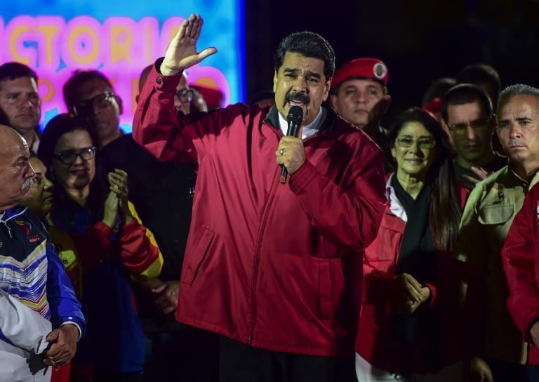 """Venezuelan president Nicolas Maduro celebrates the results of """"Constituent Assembly"""", in Caracas, on July 31, 2017. Deadly violence erupted around the controversial vote, with a candidate to the all-powerful body being elected shot dead and troops firing weapons to clear protesters in Caracas and elsewhere.  / AFP PHOTO / RONALDO SCHEMIDT"""