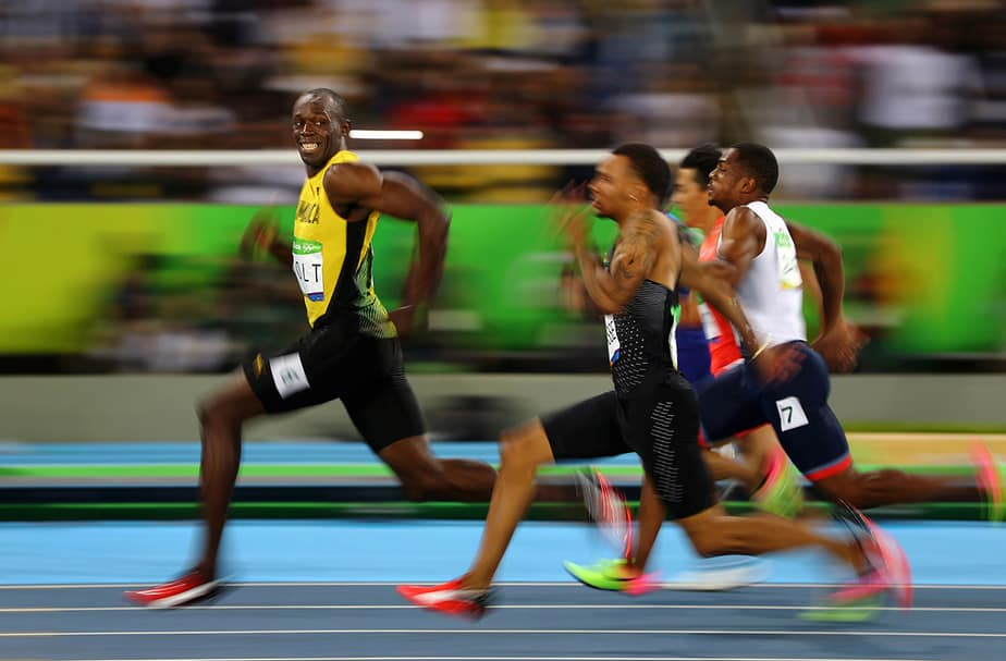 Usain Bolt of Jamaica smiles as he looks back at his competition, whilst winning the 100-meter semi-final sprint, at the 2016 Olympics in Rio de Janeiro, Brazil. Bolt is regarded as the fastest human ever timed. He is the first person to hold both the 100-meter and 200-meter world records since fully automatic time became mandatory. REUTERS/Kai Pfaffenbach TPX IMAGES OF THE DAY