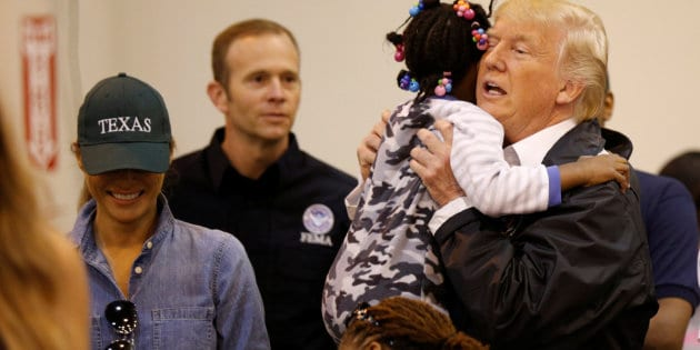 U.S. President Donald Trump and first lady Melania Trump greet children at the NRG Center where they met with flood survivors of Hurricane Harvey, in Houston, Texas, U.S., September 2, 2017.   REUTERS/Kevin Lamarque
