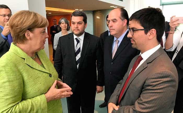 Ángela Merkel con Julio Borges y Freddy Guevara