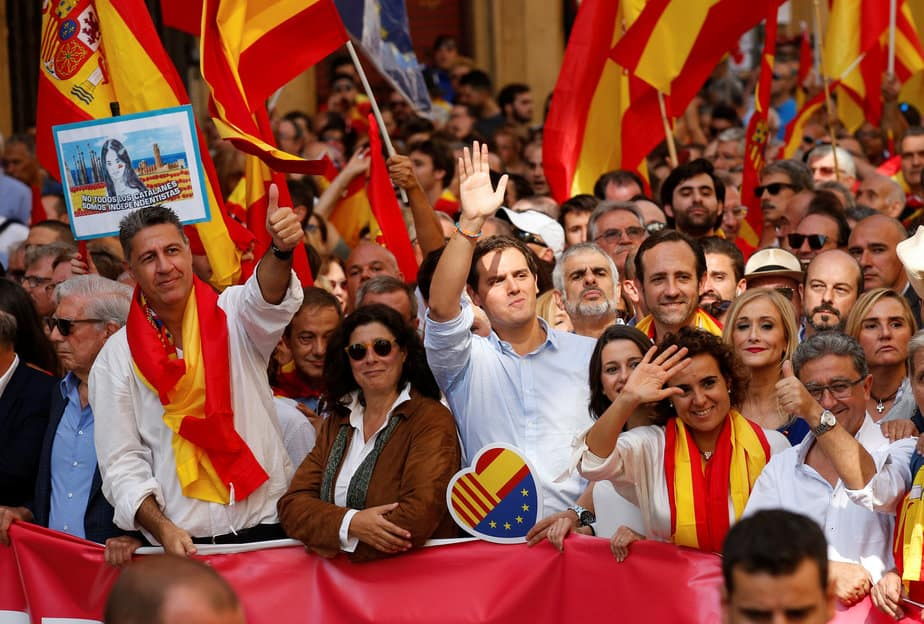 Politicians including Catalan People's Party (PP) president Xavier Garcia Albiol (2nd L) and Ciudadanos leader Albert Rivera (C) attend a pro-union demonstration organised by the Catalan Civil Society organisation in Barcelona, Spain, October 8, 2017. REUTERS/Albert Gea