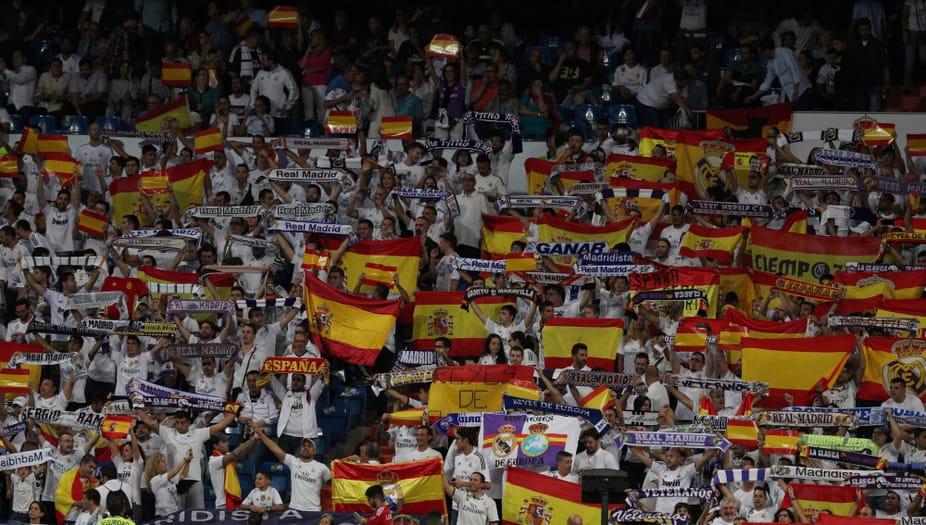Soccer Football - La Liga Santander - Real Madrid vs Espanyol - Santiago Bernabeu, Madrid, Spain - October 1, 2017   Real Madrid fans with Spanish flags   REUTERS/Rafael Marchante - RC1F1A94C480
