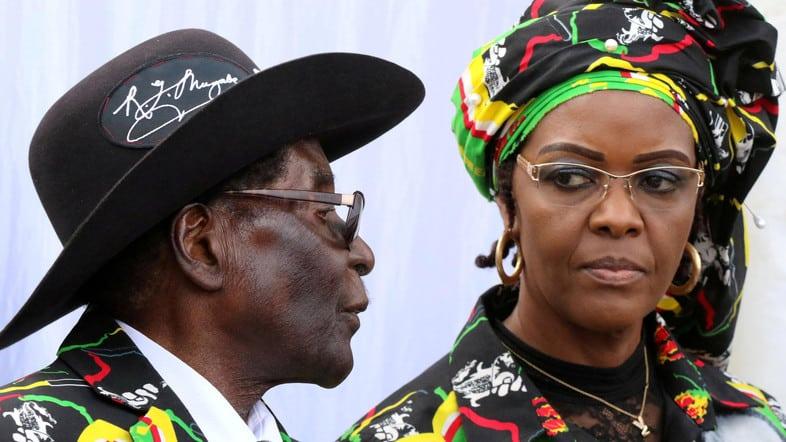 FILE PHOTO: President Robert Mugabe (L) and his wife Grace attend a rally of his ruling ZANU (PF) in Chinhoyi, Zimbabwe, July 29, 2017. REUTERS/Philimon Bulawayo/File Photo