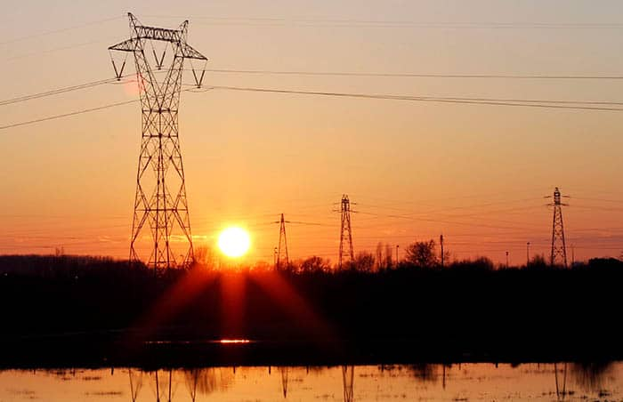Pylons of high-tension electricity power lines are seen during sunset in Bordeaux, France, January 27, 2018. REUTERS/Regis Duvignau
