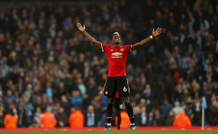 "Soccer Football - Premier League - Manchester City vs Manchester United - Etihad Stadium, Manchester, Britain - April 7, 2018   Manchester United's Paul Pogba celebrates after the match                          REUTERS/Russell Cheyne    EDITORIAL USE ONLY. No use with unauthorized audio, video, data, fixture lists, club/league logos or ""live"" services. Online in-match use limited to 75 images, no video emulation. No use in betting, games or single club/league/player publications.  Please contact your account representative for further details."