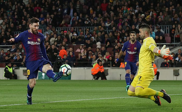 Soccer Football - La Liga Santander - FC Barcelona vs Leganes - Camp Nou, Barcelona, Spain - April 7, 2018   Barcelona's Lionel Messi scores their third goal to complete his hat-trick              REUTERS/Albert Gea