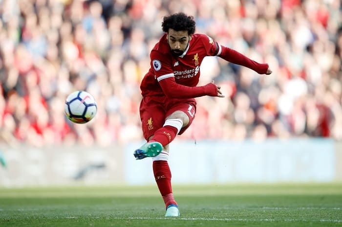 "Soccer Football - Premier League - Liverpool vs AFC Bournemouth - Anfield, Liverpool, Britain - April 14, 2018   Liverpool's Mohamed Salah shoots at goal    Action Images via Reuters/Carl Recine    EDITORIAL USE ONLY. No use with unauthorized audio, video, data, fixture lists, club/league logos or ""live"" services. Online in-match use limited to 75 images, no video emulation. No use in betting, games or single club/league/player publications.  Please contact your account representative for further details."