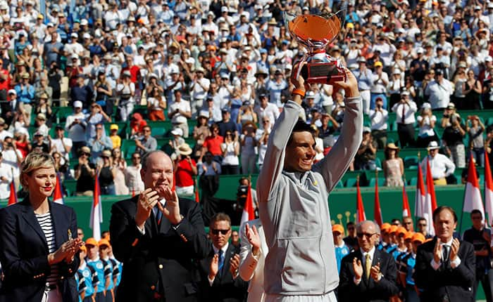 Tennis - ATP - Monte Carlo Masters - Monte-Carlo Country Club, Monte Carlo, Monaco - April 22, 2018   Spain's Rafael Nadal celebrates with the trophy after winning the final against Japan's Kei Nishikori as Princess Charlene of Monaco and Prince Albert II of Monaco applaud   REUTERS/Eric Gaillard
