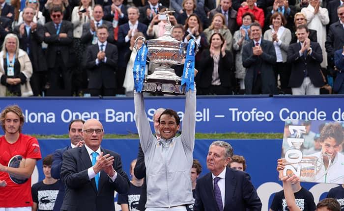 Tennis - ATP 500 - Barcelona Open - Real Club de Tenis Barcelona-1899, Barcelona, Spain - April 29, 2018   Spain's Rafael Nadal celebrates with the trophy after winning the final against Greece's Stefanos Tsitsipas   REUTERS/Albert Gea