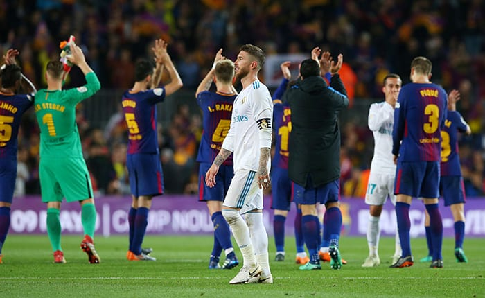 Soccer Football - La Liga Santander - FC Barcelona v Real Madrid - Camp Nou, Barcelona, Spain - May 6, 2018   Real Madrid's Sergio Ramos looks dejected as Barcelona's Marc-Andre ter Stegen and team mates applaud the fans at the end of the match    REUTERS/Albert Gea