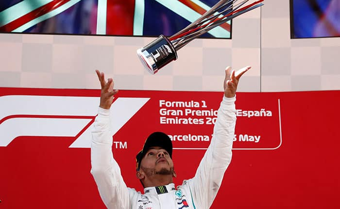Formula One F1 - Spanish Grand Prix - Circuit de Barcelona-Catalunya, Barcelona, Spain - May 13, 2018   Mercedes' Lewis Hamilton celebrates winning the race with the trophy   REUTERS/Juan Medina