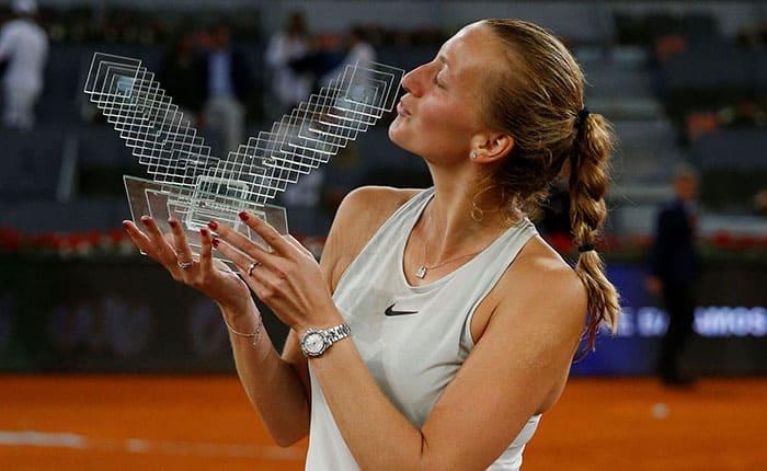 Tennis - WTA Mandatory - Madrid Open - Madrid, Spain - May 12, 2018   Czech Republic's Petra Kvitova celebrates with the trophy after winning the final against Netherlands' Kiki Bertens    REUTERS/Paul Hanna