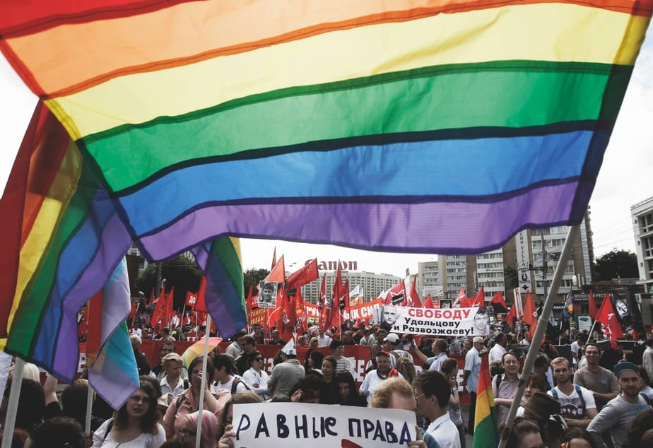 "Gay rights activists take part in an opposition protest march in Moscow, June 12, 2013. Thousands of protesters marched in Moscow on Wednesday, calling for Russian President Vladimir Putin's resignation and the release of activists facing long jail terms over violence at a rally on the eve of his inauguration to a third term last year. Banner read, ""Equal rights"". REUTERS/Maxim Shemetov (RUSSIA - Tags: POLITICS CIVIL UNREST) - GM1E96C1E8E01"