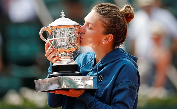 Tennis - French Open - Roland Garros, Paris, France - June 9, 2018   Romania's Simona Halep celebrates with the trophy after winning the final against Sloane Stephens of the U.S.    REUTERS/Pascal Rossignol